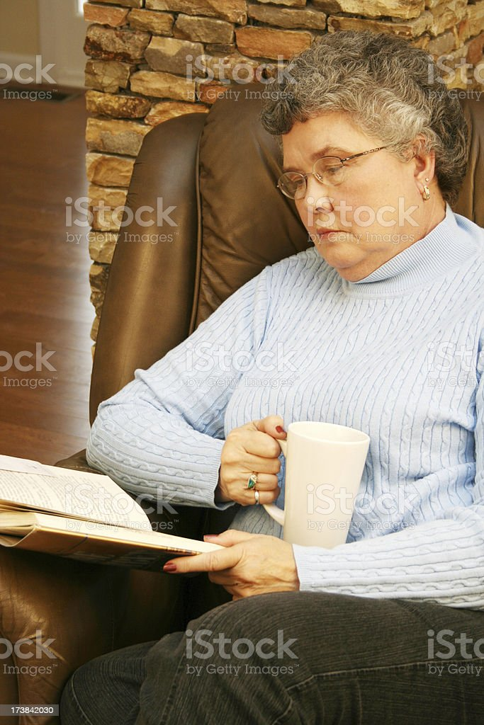 Senior Woman Reading A Book royalty-free stock photo