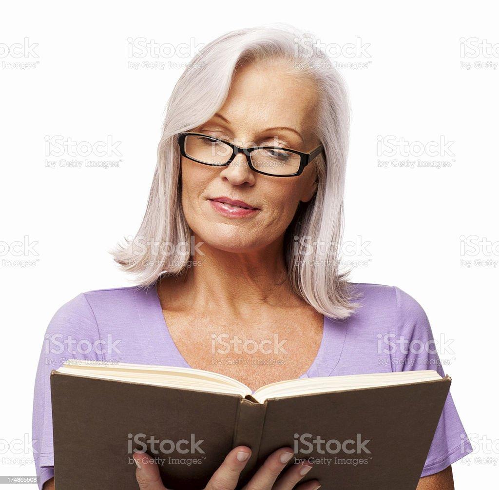 Senior Woman Reading Book - Isolated royalty-free stock photo