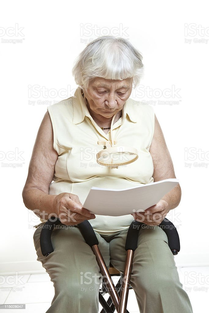 Senior Woman Reading Contract Agreement stock photo