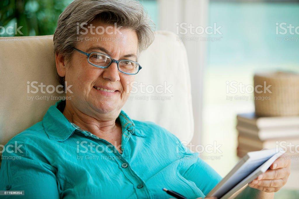 senior woman reading stock photo