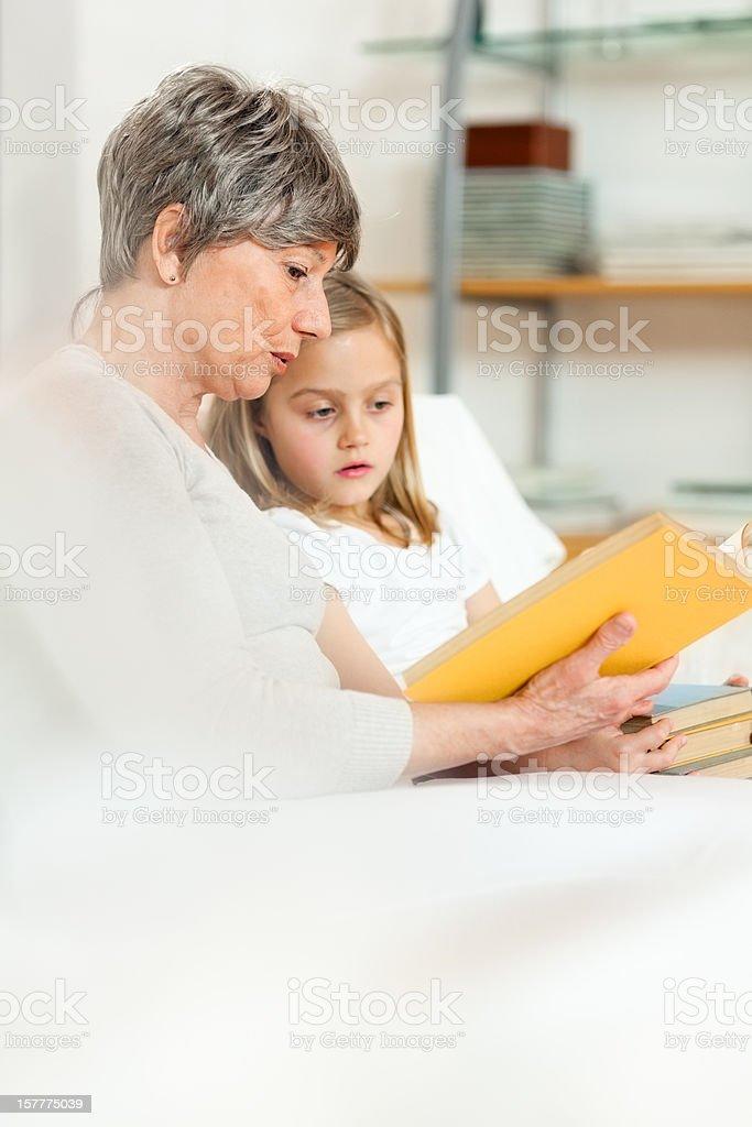 Senior Woman Reading To Little Girl royalty-free stock photo