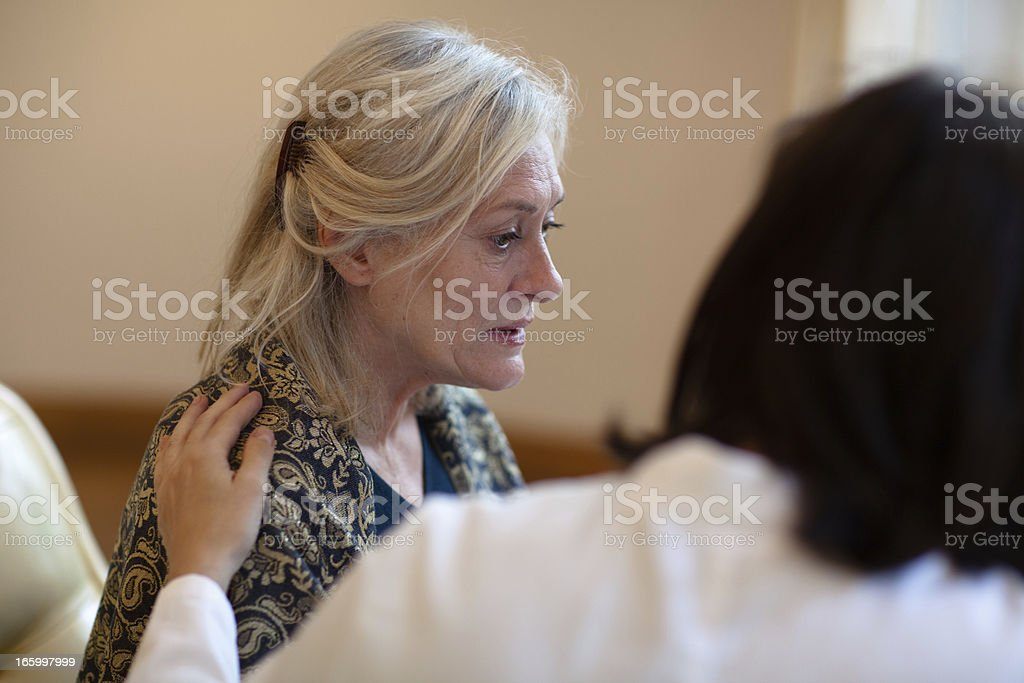 Senior woman receiving help on care home stock photo