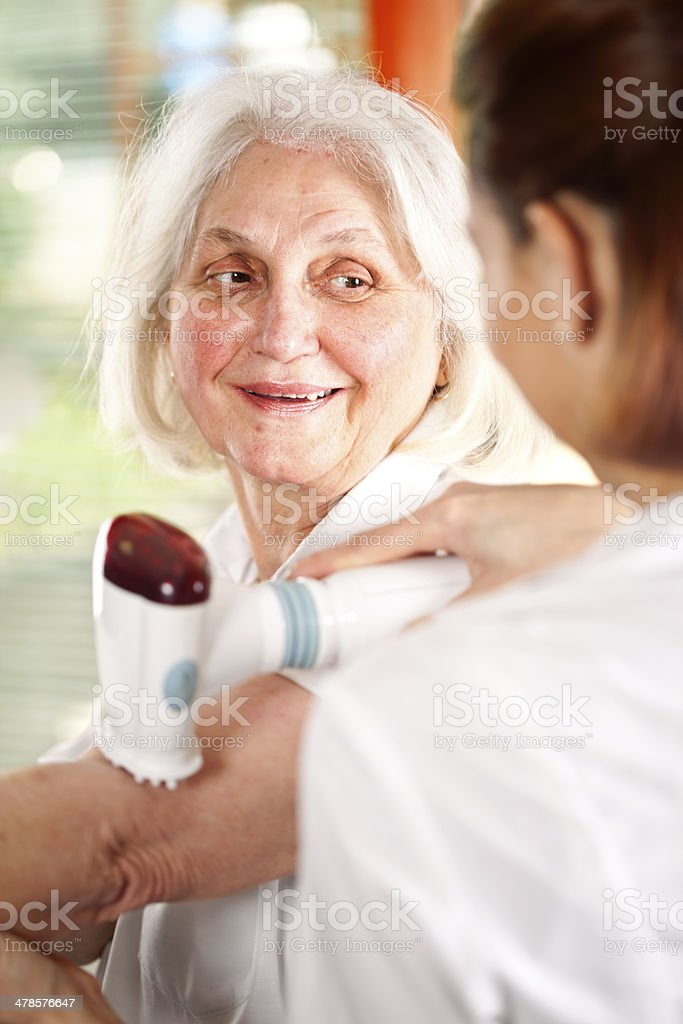 Senior woman receiving home therapy stock photo