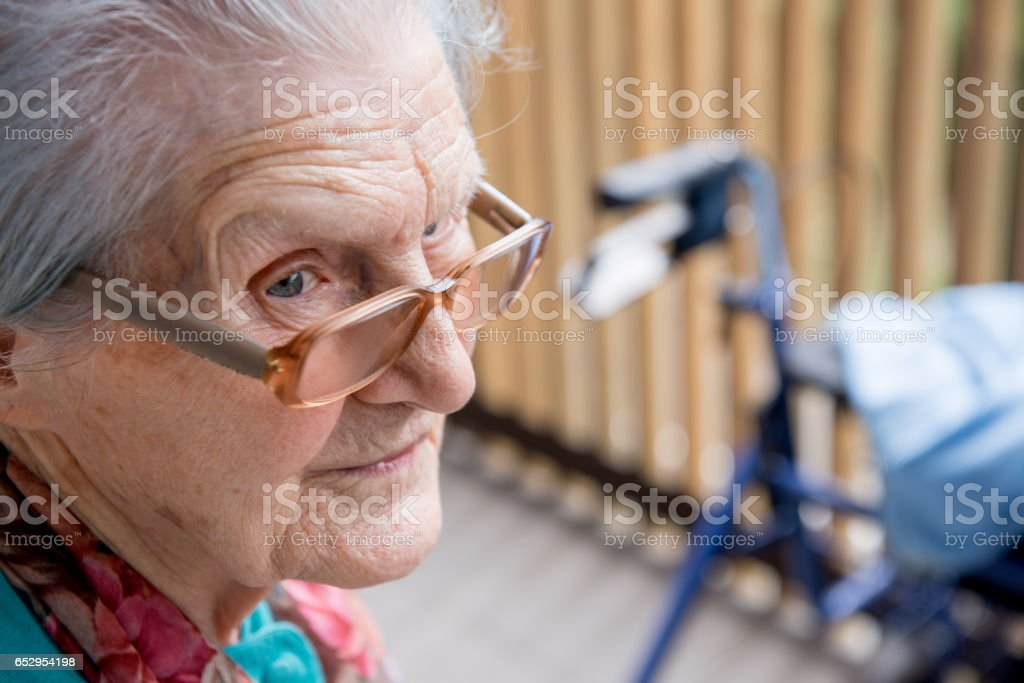 Senior Woman Relaxing Outdoors At The Nursery Home stock photo