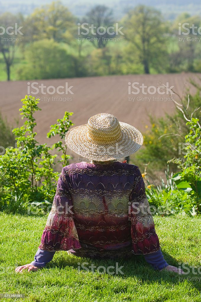 Senior woman relaxing outdoors royalty-free stock photo