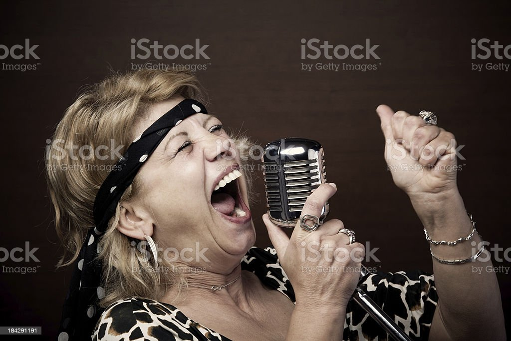 Senior woman rock star singing stock photo