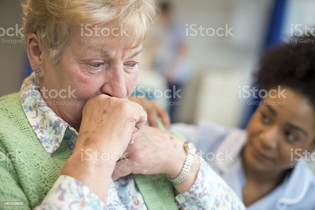 senior woman sad in hospital stock photo