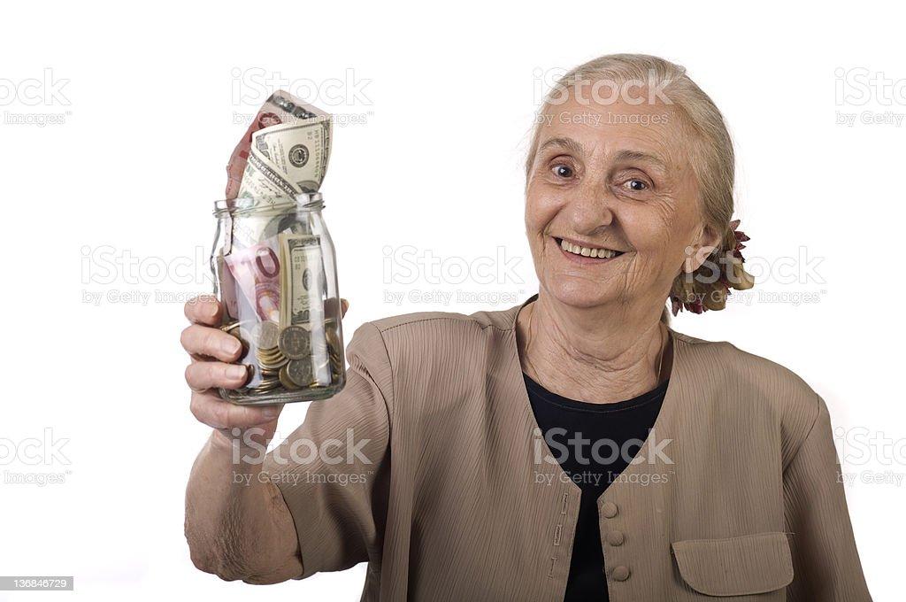senior woman saving money on time royalty-free stock photo