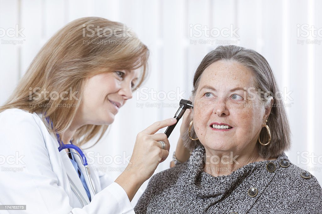 Senior Woman Seeking Medical Healthcare Service at Doctor's Office Close-up stock photo