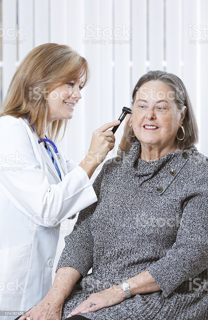 Senior Woman Seeking Medical Healthcare Service at Doctor's Office Vt stock photo