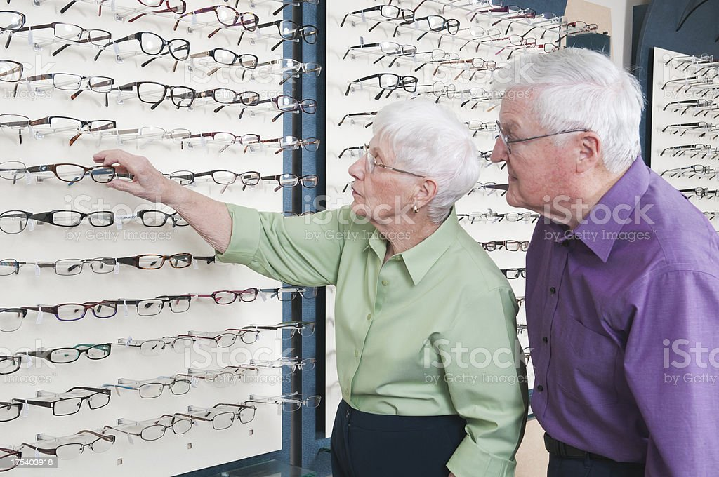 Senior Woman Selecting New Glasses royalty-free stock photo
