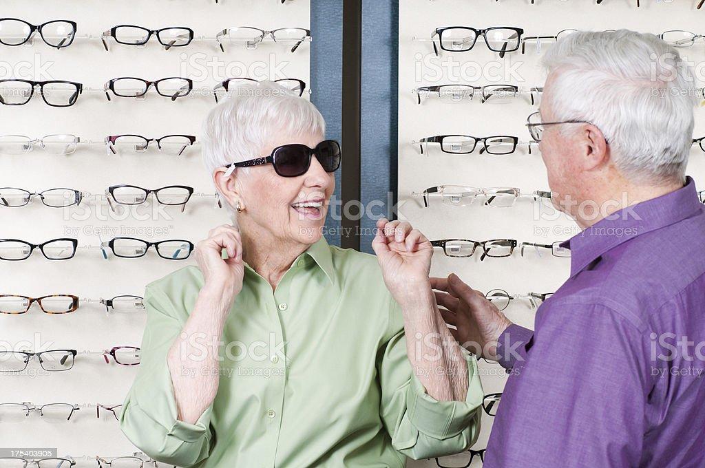 Senior Woman Selecting New Sunglasses royalty-free stock photo