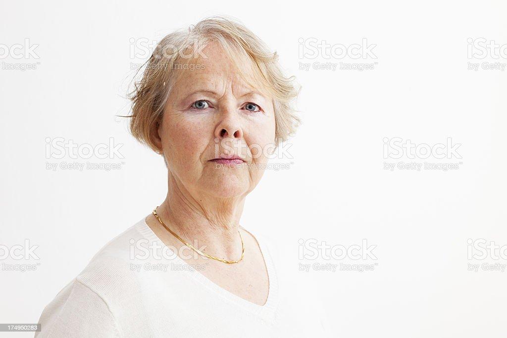 senior woman serious worries royalty-free stock photo
