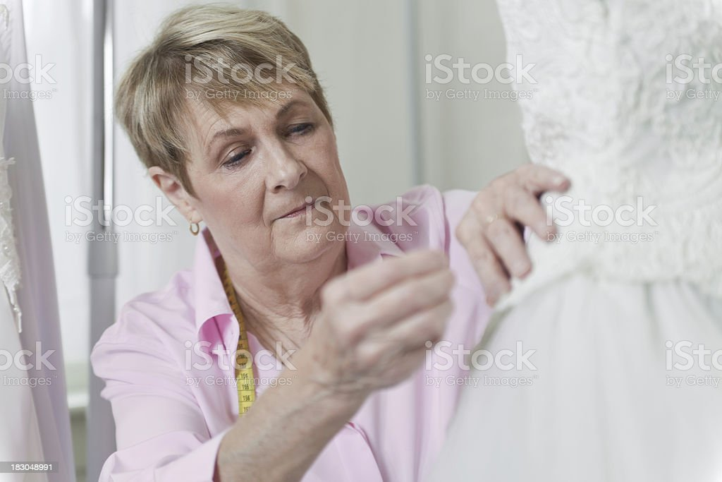 Senior woman sewing gown royalty-free stock photo