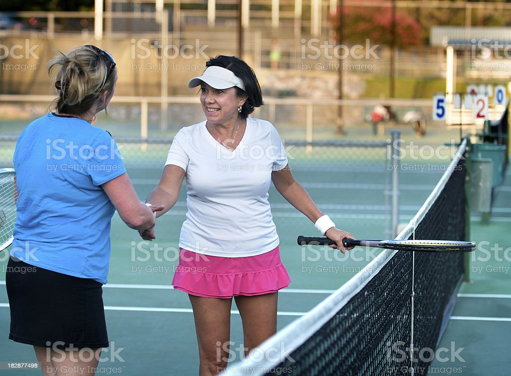 Senior Woman Shaking Hands After Tennis Match royalty-free stock photo