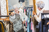 Senior woman shopping in a clothng store