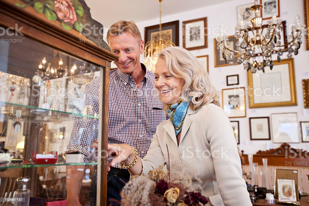 Senior woman shopping in an antiquity store stock photo