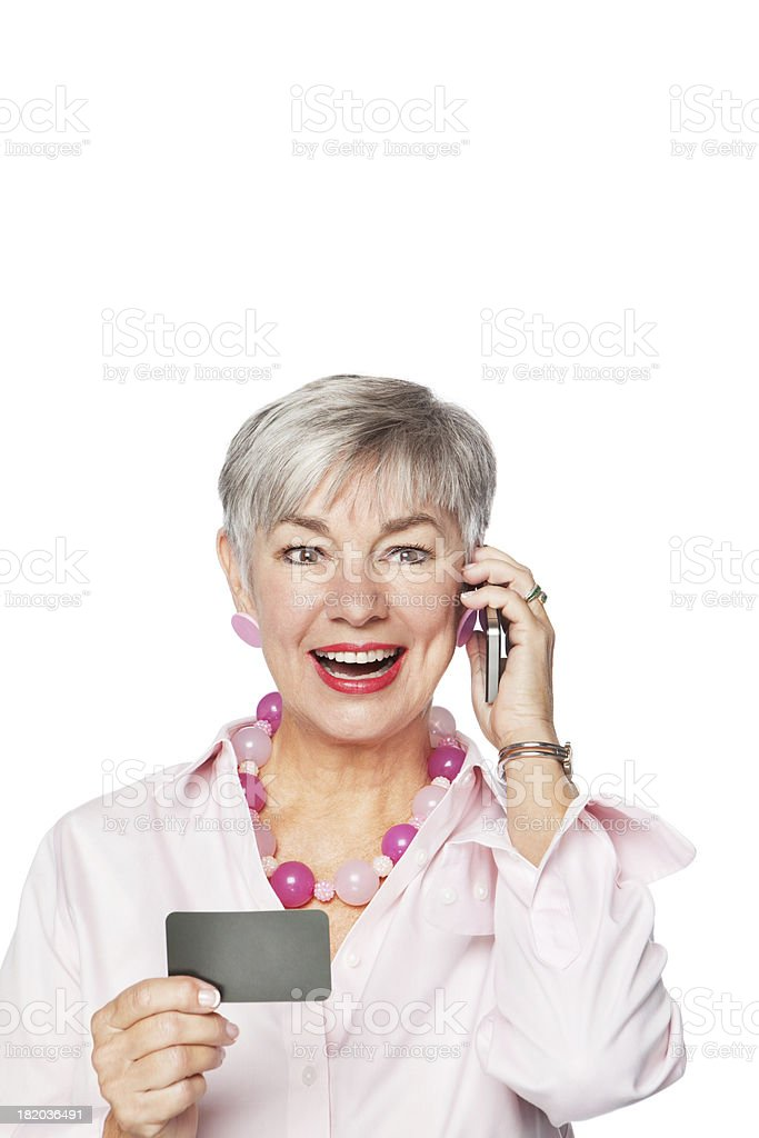 Senior Woman Shopping On Call With Credit Card royalty-free stock photo