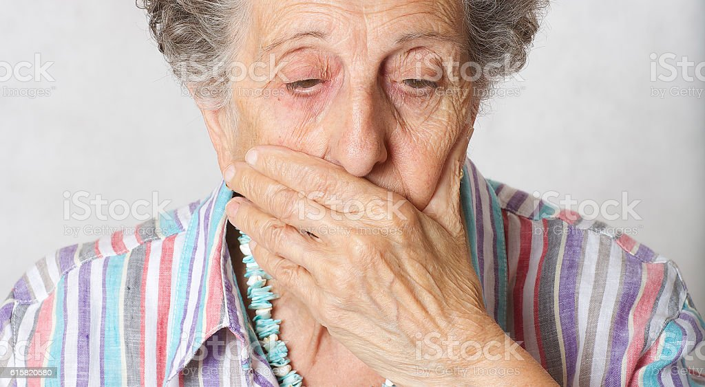 Senior woman show that her right are limited stock photo