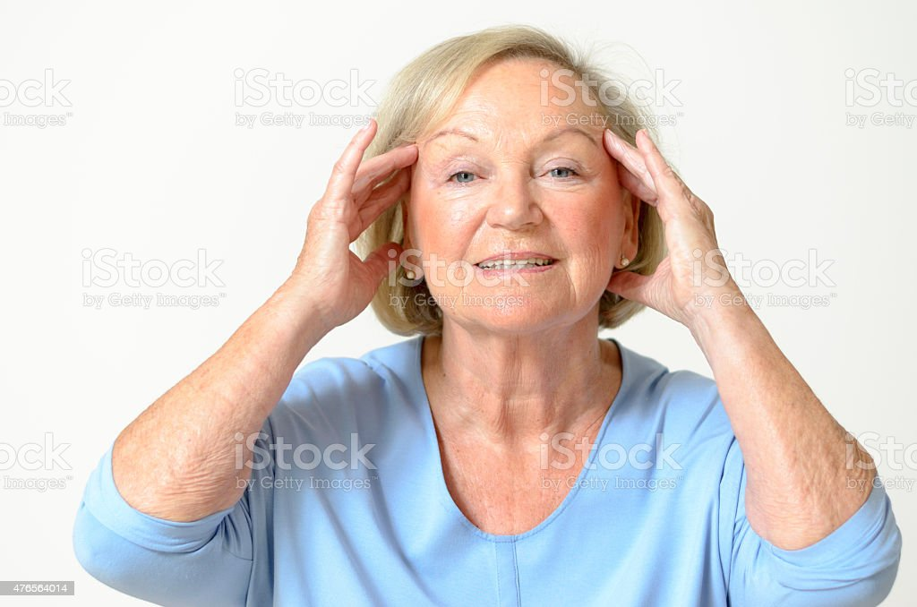 Senior woman showing her face, effect of aging stock photo