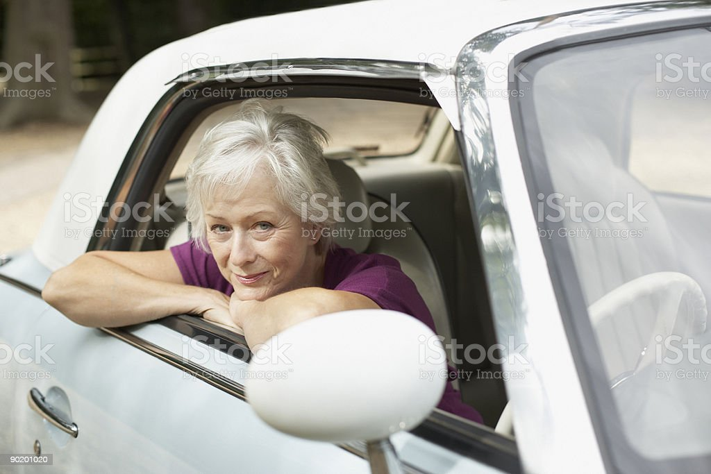Senior woman sitting in car royalty-free stock photo