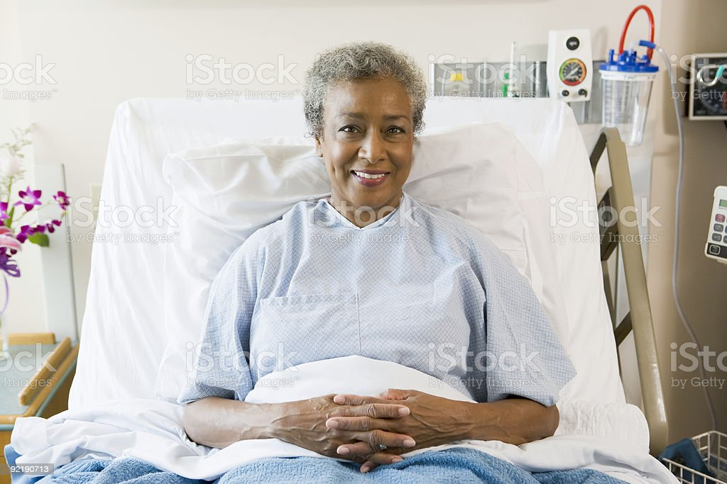 Senior Woman Sitting In Hospital Bed stock photo
