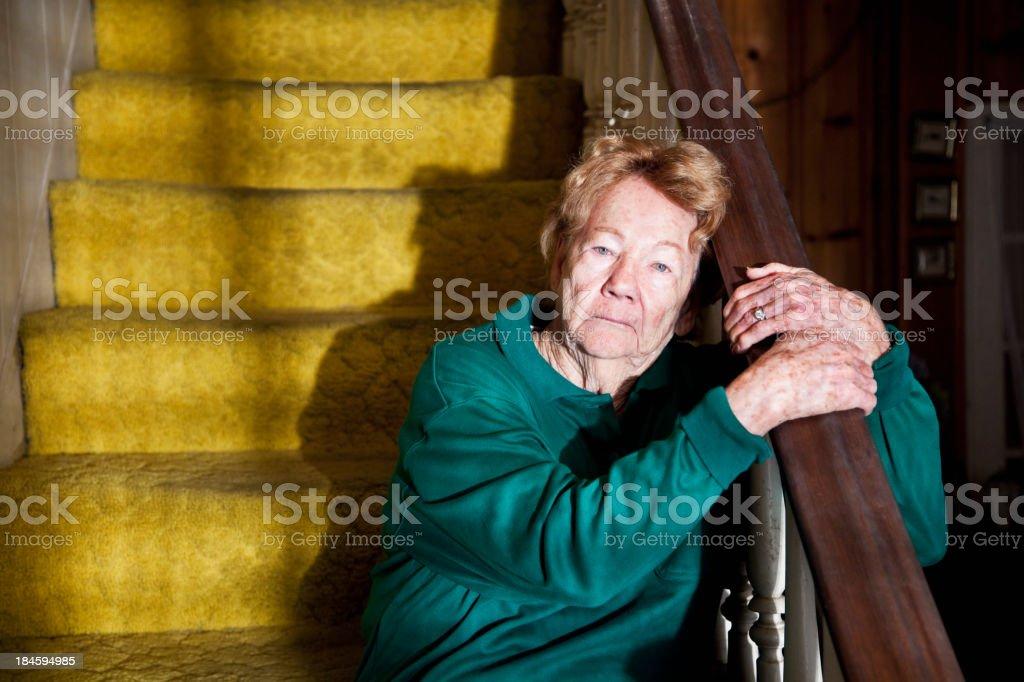Senior woman sitting on staircase royalty-free stock photo