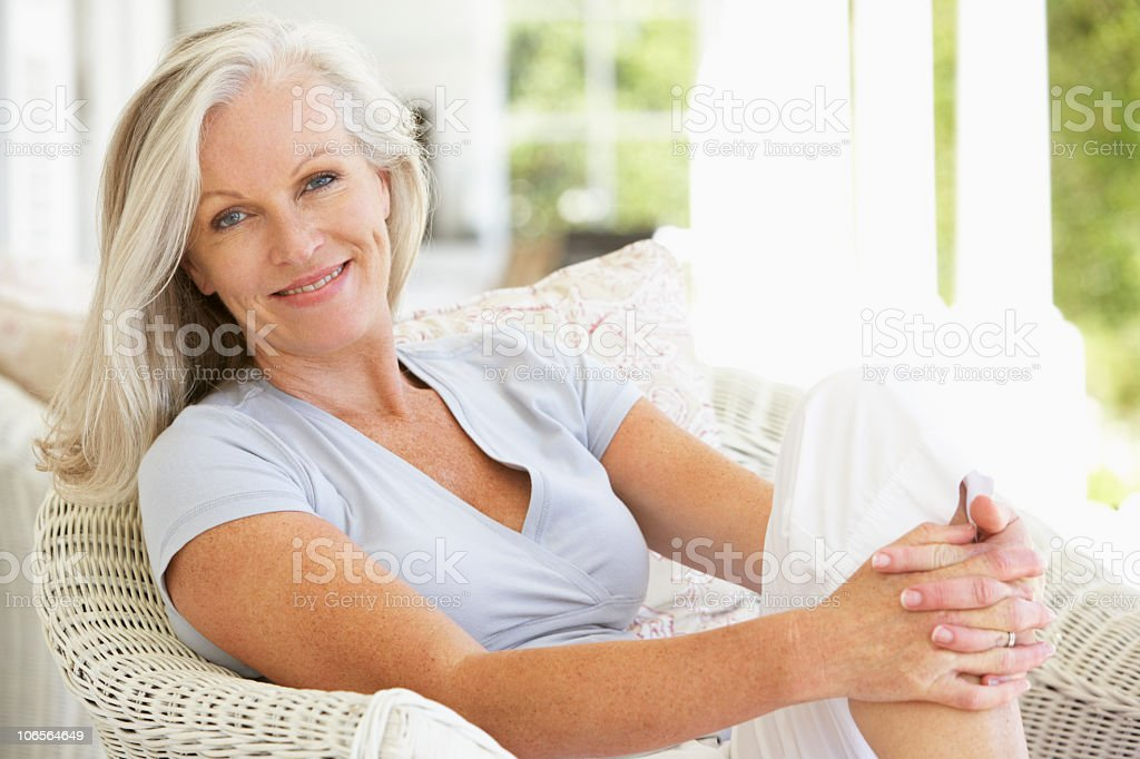 Senior Woman Sitting Outside stock photo