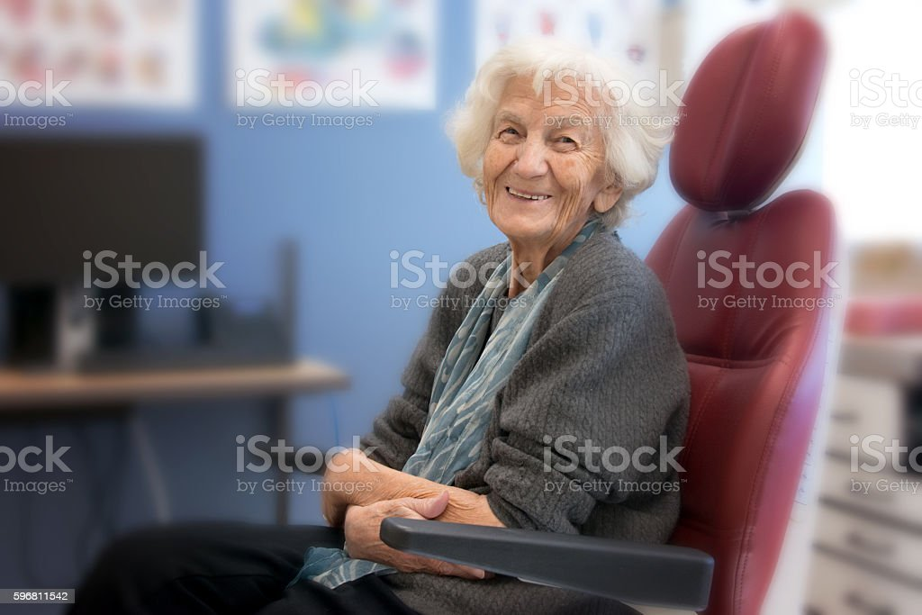 Senior Woman Smiling, Dentist or Doctor Office stock photo