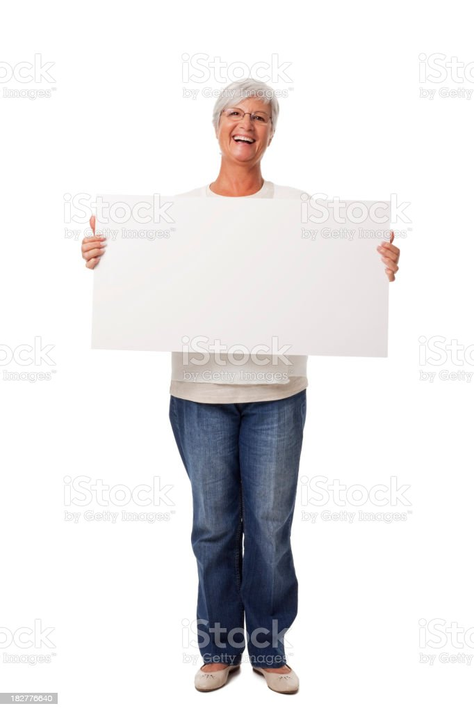 Senior Woman Smiling Holding Blank Placard Isolated on White royalty-free stock photo