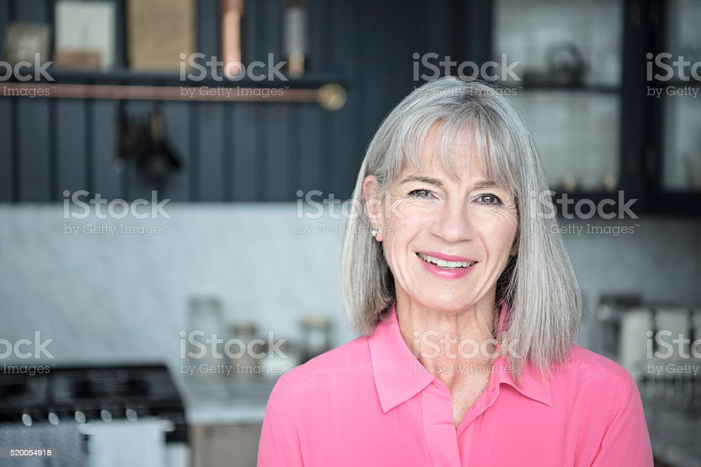 Senior woman smiling towards camera stock photo