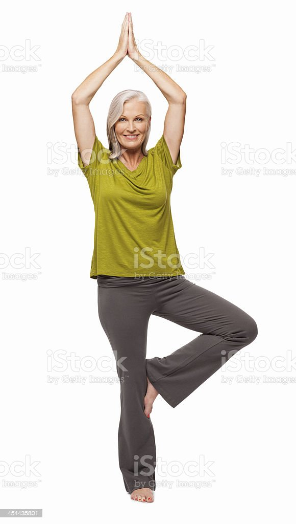Senior Woman Standing In Yoga Tree Posture - Isolated stock photo