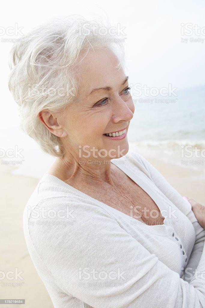 Senior Woman Standing On Beach royalty-free stock photo