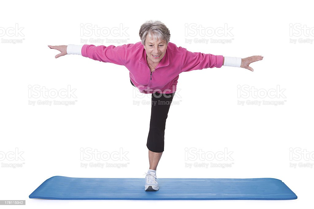 Senior Woman Standing On One Leg And Exercising royalty-free stock photo