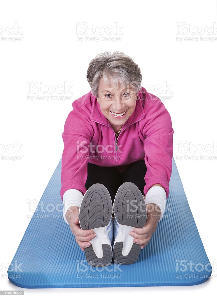 Senior Woman Stretching Her Legs royalty-free stock photo