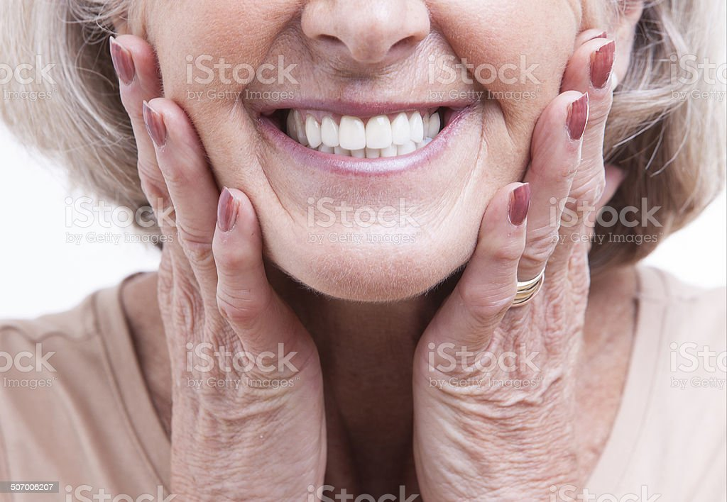 Senior woman studio portrait stock photo