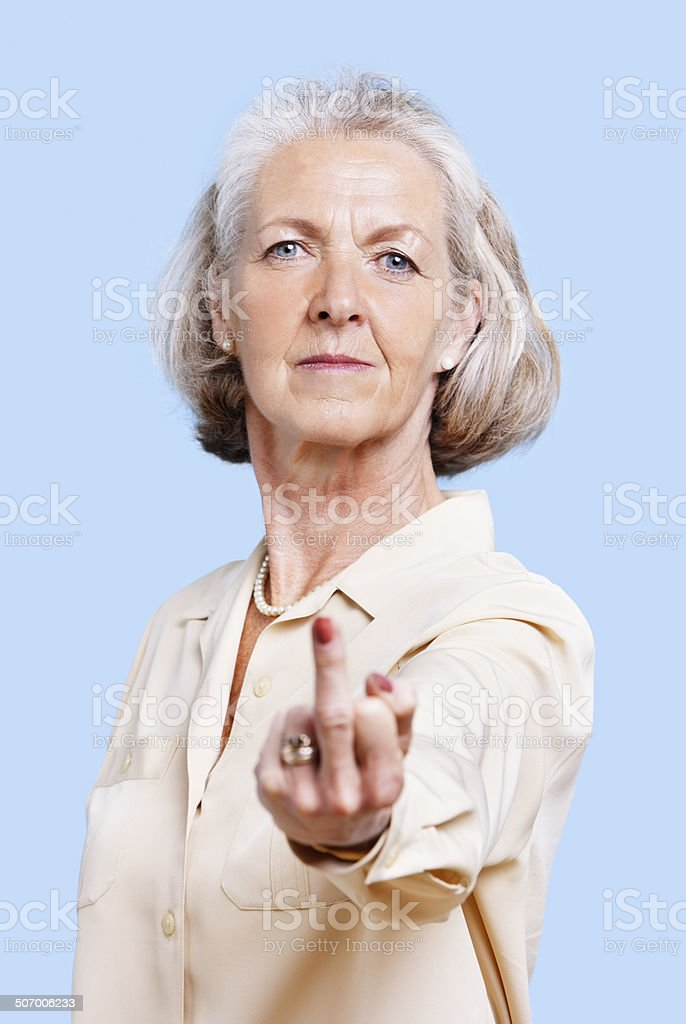 Senior woman studio portrait stock photo