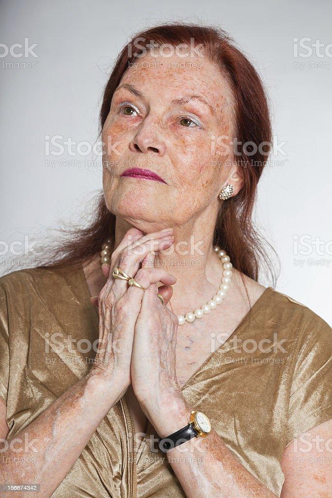 Senior woman studio shot against grey background royalty-free stock photo