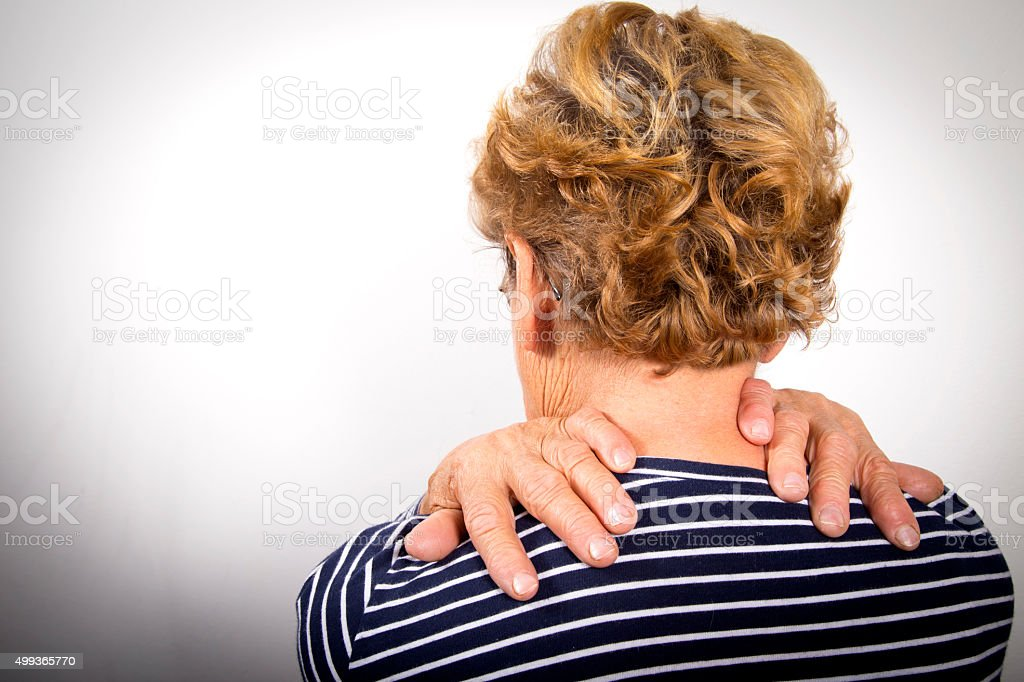 Senior woman suffering from neck pain royalty-free stock photo