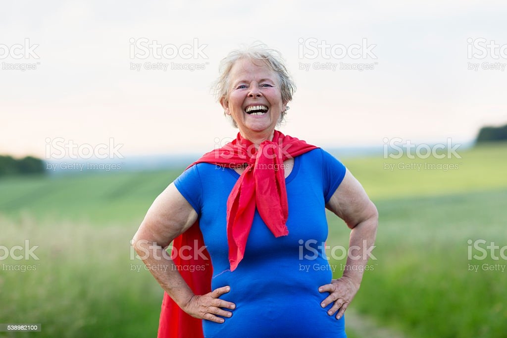 senior woman superhero stock photo