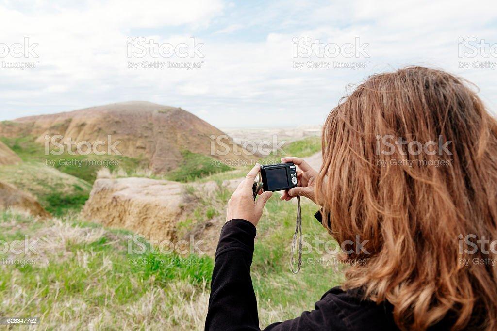 Senior Woman Takes Pictures Badlands National Park South Dakota stock photo