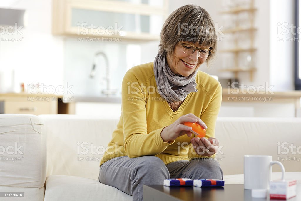 Senior Woman taking medicine stock photo