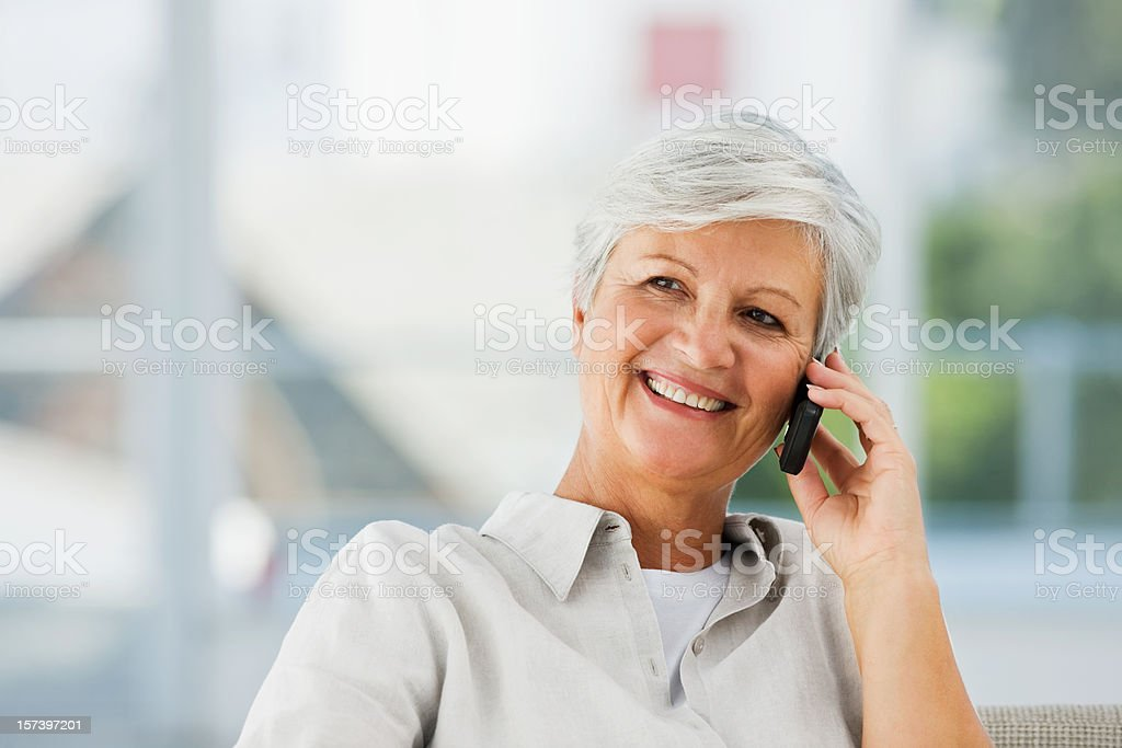 Senior woman talking on cellphone royalty-free stock photo