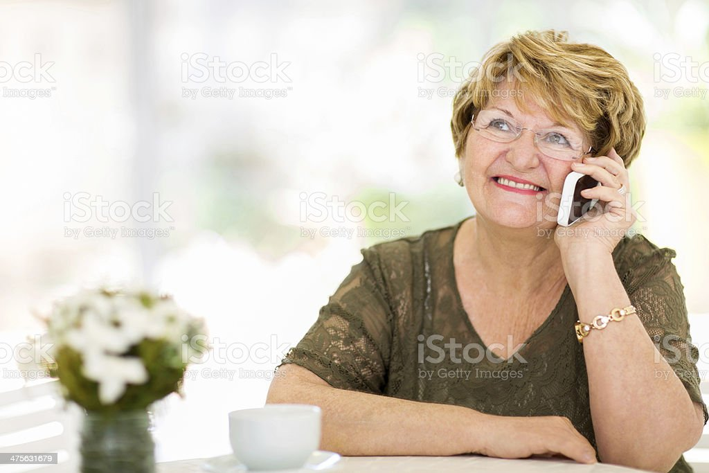senior woman talking on her cell phone stock photo