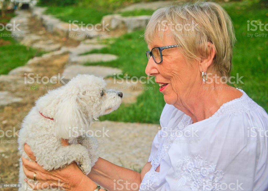 Senior Woman Talking to her Dog stock photo
