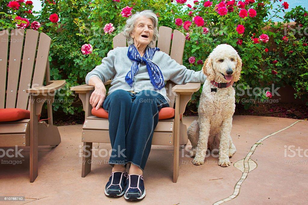 Senior Woman Talking to Service Dog stock photo