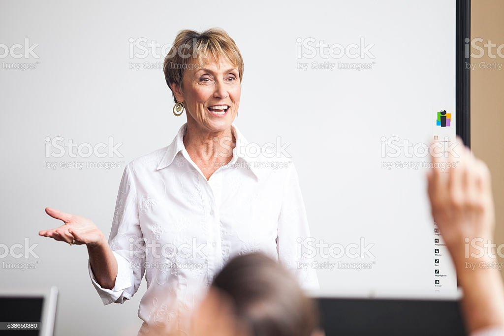 Senior Woman Teaching Adult Learning Class stock photo