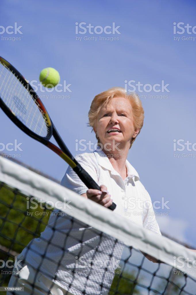 senior woman tennis volley royalty-free stock photo