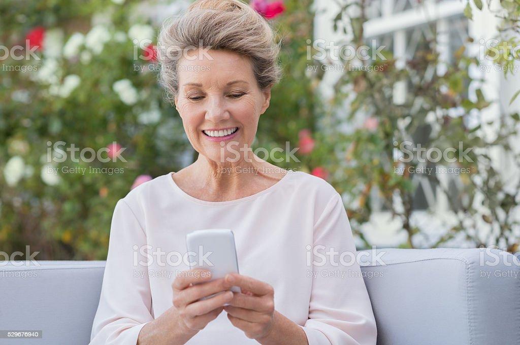 Senior woman texting message stock photo