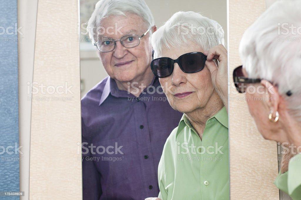 Senior Woman Trying On New Sunglasses royalty-free stock photo